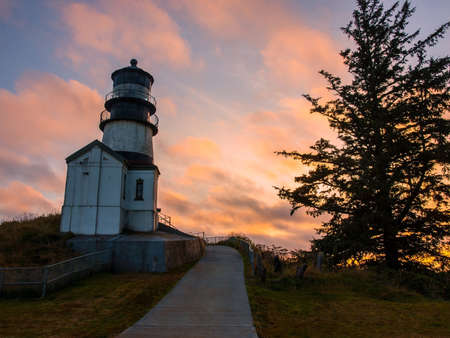 guard house: Cape Disappointment Lighthouse at Sunset in Fort Canby State Park near Ilwaco Washington USA Stock Photo