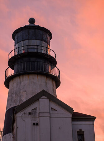 Cape Disappointment Lighthouse at Sunset in Fort Canby State Park near Ilwaco Washington USA photo