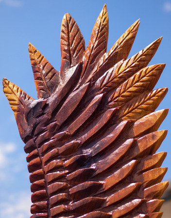 Closeup of an Eagle Wing Chainsaw Sculpture Showing Carved and Burned Wood Banque d'images