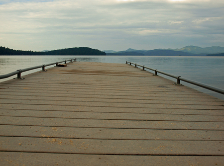 Wooden Dock on a Calm Lake Stock Photo