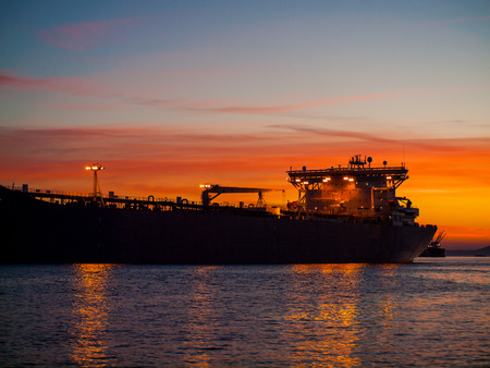 Large Cargo Ship at Sunset in a Port