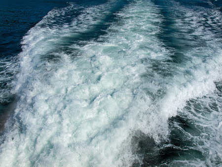 Wake Trail on the Water Behind a Fast Moving Motor Boat