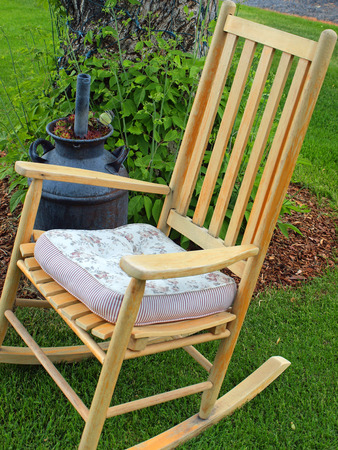 Wooden Rocking Chairs on a Beautiful Green Lawn