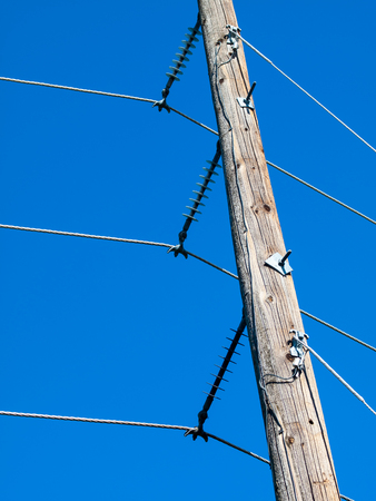 power pole: Power Line Attached to Power Pole Stock Photo
