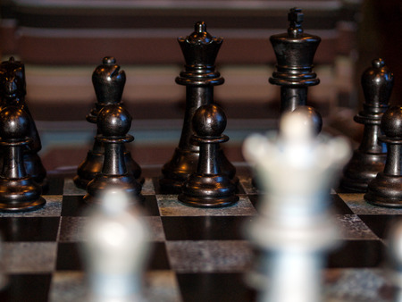 Wooden Chess Pieces on a Wooden Chessboard Stock Photo