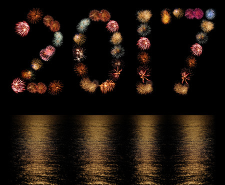 Firework Bursts Arranged as the Number 2017 with Reflections