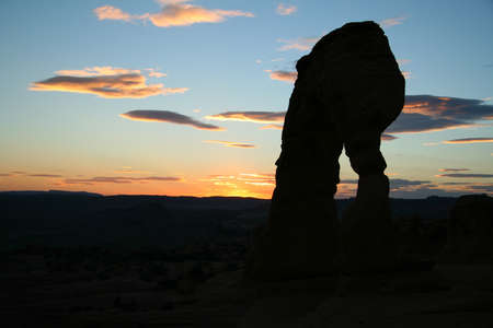 haunt: Sunset at the Delicate Arch at the Arches National Park - USA Stock Photo