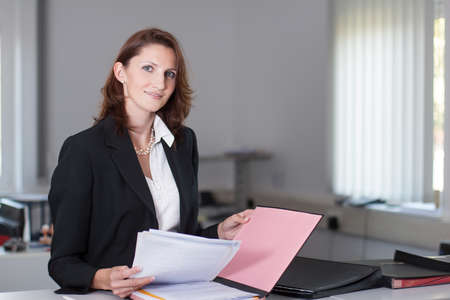 woman handle success: Businesswoman checks documents in the office Stock Photo