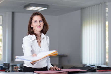 file clerks: Office clerk delivers documents in the office