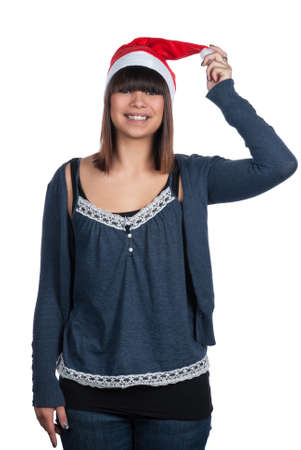 bobble: Cut out image of a young woman with a red white Christmas bobble hat  Woman holds the flap of the hat  Stock Photo