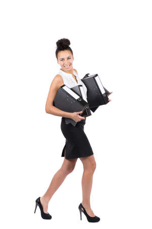 sympathetic: Cut out image of a young beautiful business woman who walks with several files holding in her arms Stock Photo