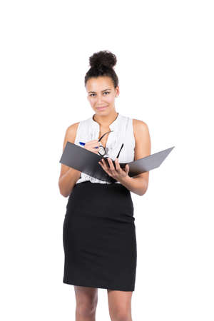 file clerks: Cut out image of a young beautiful business woman who holds an opened file, a pen and glasses