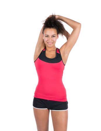 Cut out image of a young woman who is stretching her arm musculature photo
