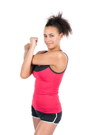 musculature: Cut out image of a young woman who is stretching her arm musculature