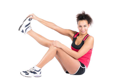 musculature: Cut out image of a young woman who is stretching her musculature
