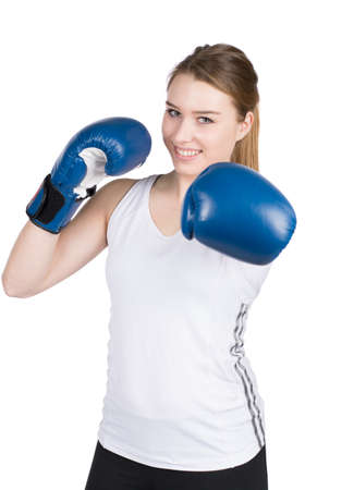likeable: Young smiling sportswoman is boxing with blue boxing gloves. Face is in focus. Stock Photo