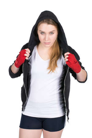 hoody: Cut out image of a young female boxer wearing a hoody and with bandaged hands