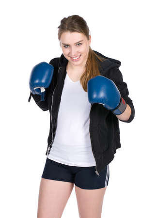 hoody: Cut out image of a young smiling female boxer wearing a hoody and with blue boxing gloves Фото со стока