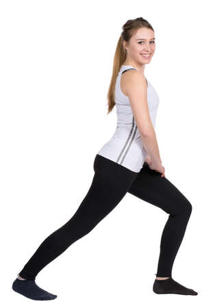 likeable: Cut out image of a young woman who is stretching her leg musculature Stock Photo
