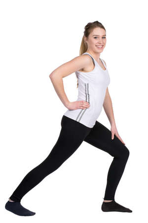 musculature: Cut out image of a young woman who is stretching her leg musculature Stock Photo