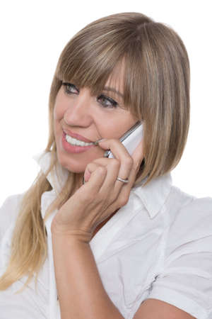 fair haired: Cut out image of a smiling businesswoman who is phoning with a smart phone. The woman is looking to the left.