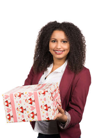 likeable: Cut out image of a young woman who is holding a christmas gift