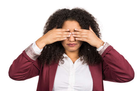likeable: Cut out image of a young woman with brown curly hair (afro) who covers her eyes with her hands.