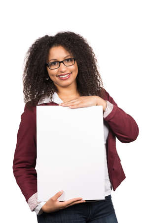 likable: Cut out image of a young woman with brown curly hair (afro) and glasses who is holding a white empty sheet of paper.