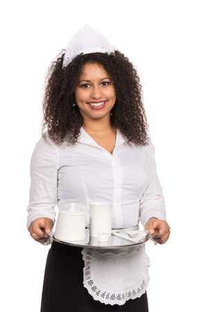 likable: Cut out image of a young smiling serving woman with brown curly hair (afro) who is holding a tablet coffee. The woman is wearing a service apron and cap.