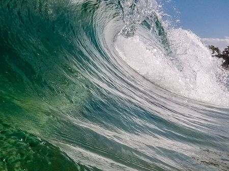 A wave breaks at the sea