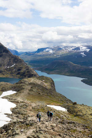 Hikers on the Besseggen mountain trail in Jotunheimen National Park in Norway Stock Photo