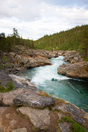 Beautiful mountain stream with clear water in Norway near Besseggen Stock Photo