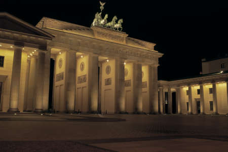 The famous Brandenburg gate in Berlin at night  photo
