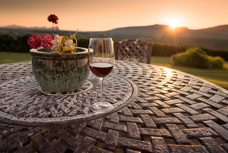 Dingle, Ireland - Relaxing glass of red wine catching the sunset light