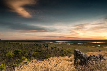 Dusk at Ubirr rock looking down at the sun reflected in the waters of the Nadab floodplains. Northern Territory, Australia Stock Photo