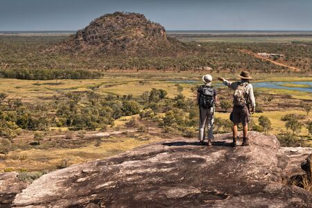 Two hikers view Arguluk Hill from Injalak Hill. Northern Territories, Australia