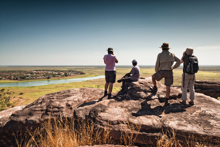 Four hikers at the top of Injalak Hill. Northern Territories, Australia