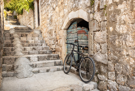 Single bicycle at the bottom of in a steep alleyway in Dubrovnik, Croatia Stock Photo