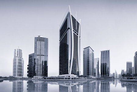 Jumeirah Lake Towers reflected on the Almas Lake. Dubai, United Arab Emirates