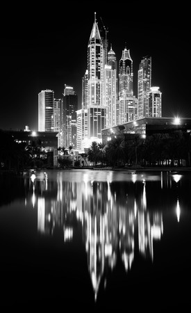 Night skyline of Dubai Marina residential district with reflections, Dubai, United Arab Emirates