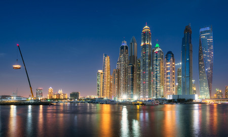Night view of Dubai Marina with reflectons in the harbour at blue hour Stock Photo