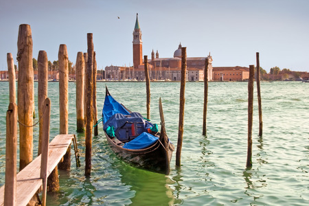 Single gondola moored on the Grand Canal in front of the San Giorgio church, Venice, Italy