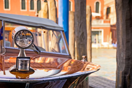 Classic vintage wooden 1960s speedboat in the Grand Canal, Venice, Italy