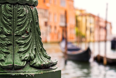 Detail view of cast iron lamp post with gondolas and the Grand Canal, Venice, Italy