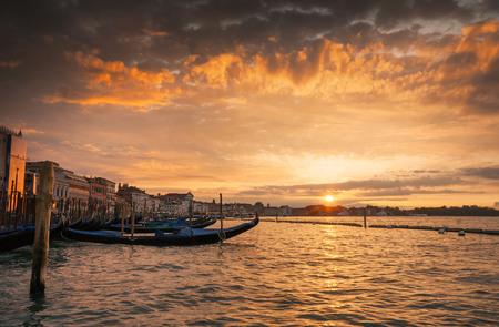 Gondolas at sunset on the Grand Canal, Venice, Italy Stock Photo