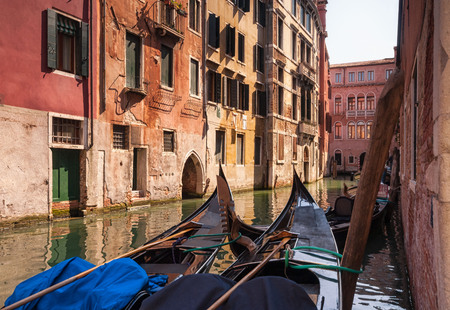 Two gondolas in a small picturesque medieval canal. Venice, Italy Stock Photo