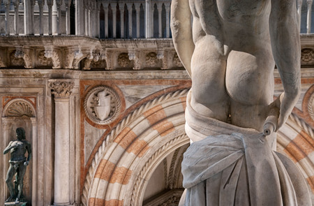 Sculpture detail of classic male form, focussing on derriere  posterior  ass.  Venice, Italy Stock Photo