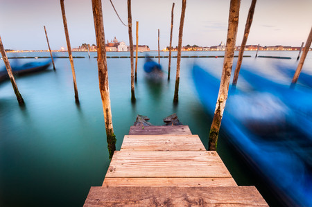 Long exposure view of gondolas and San Giorgio church across the Grand Canal, Venice, Italy