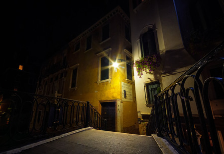 Baroque architecture on the streets and canals of Venice at night