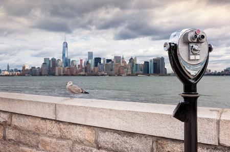 USA, New Jersey, View on Manhattan skyline from Ellis Island, Binoculars in foreground Stock Photo